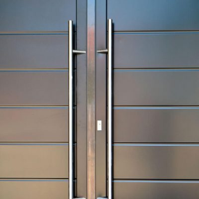 Dual black aluminium entrance door close up