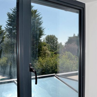Grey aluminium casement window and handle